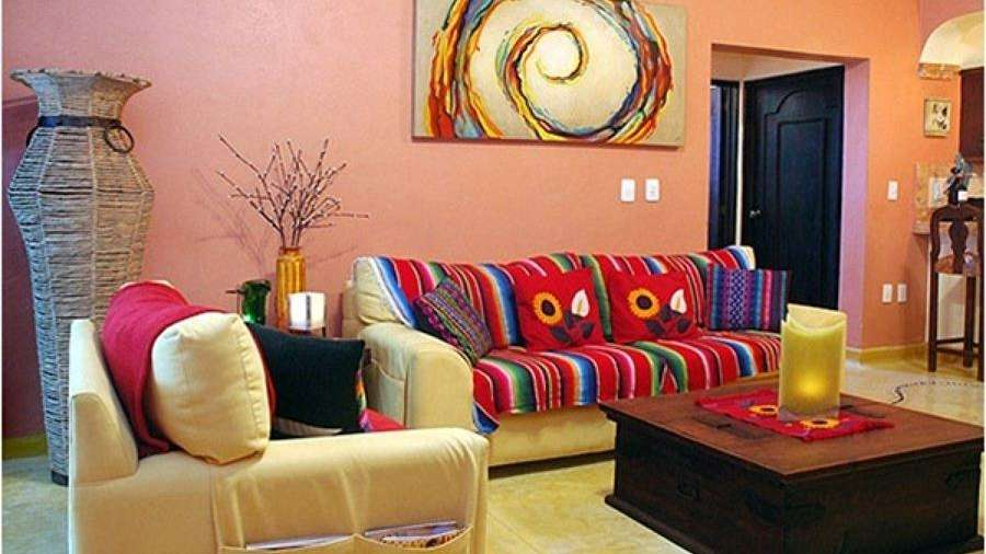 Tips para decorar con el colorido del estilo mexicano for Decorar muebles con tela