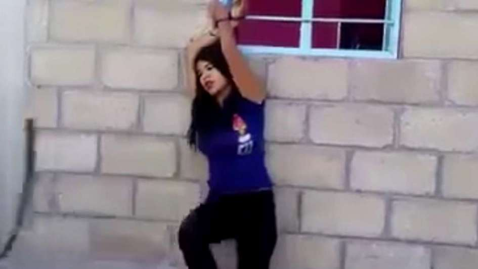 (VIDEO) Tortura a joven acusada de infidelidad y es grabada en video