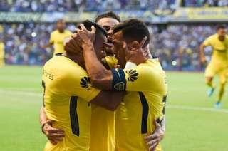 Tevez, Pavón y Nandez festejan el triunfo de Boca ante San Martín de San Juan.