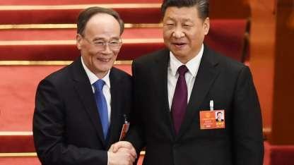 Xi (corbata morada) tendrá e Wang a su mano derecha / AFP