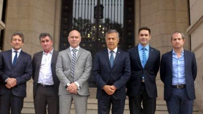 El gobernador Cornejo, el ministro Garay y el fiscal Simón en la audiencia de ayer.