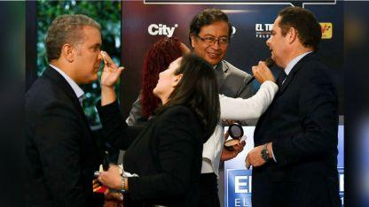 Los candidatos Iván Duque (izq.), Gustavo Petro (centro) y Germán Vargas Lleras (der.), en la previa del debate por TV.