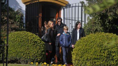 María Emilia Fernández Rousse, madrina de Geñi, junto a César Bustos y su hijo Cesarito