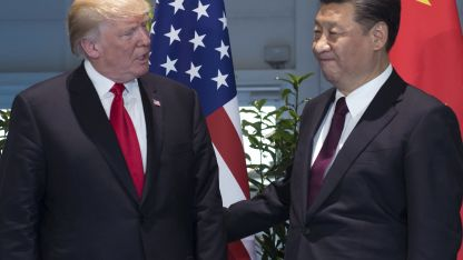 Donald Trump junto a Xi Jinping
