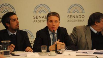 El ministro Nicolás Dujovne desmintió a Marcos Peña.