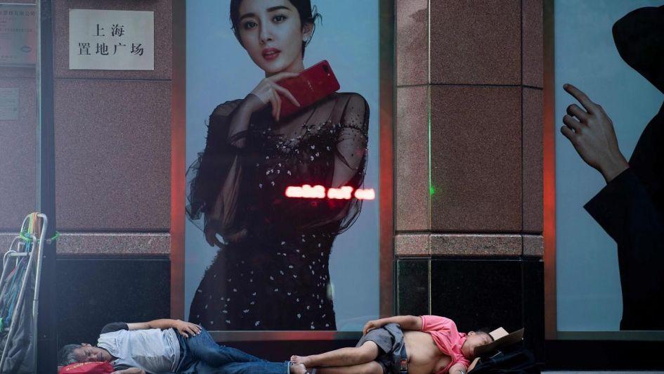 Fotogalería: cientos de chinos duermen en la calle por el insoportable calor