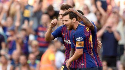 Messi festeja  su gol con Munir.