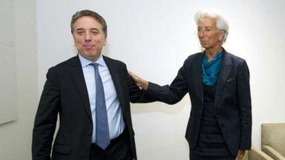 Dujovne y Lagarde. La líder del Fondo estudia la nueva propuesta.
