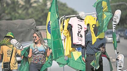 """Apoyo. Muchos brasileños votan al candidato ultraderechista por sus promesas de """"mano dura"""" contra la delincuencia."""