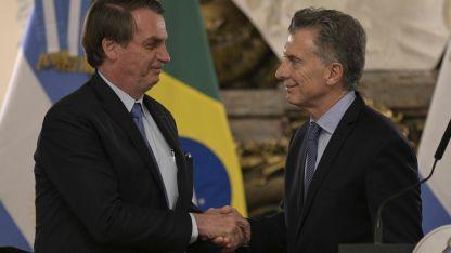 Ambos mandatarios, durante la visita de Bolsonaro al país este jueves,